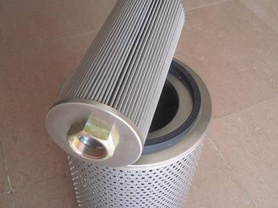 A air filter with pleated media mesh is on a perforated air filter.